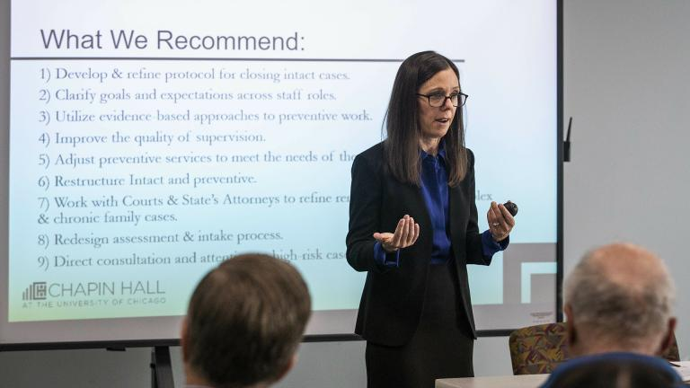 In this May 13, 2019 photo, Dana Weiner, policy fellow at Chapin Hall at the University of Chicago, discusses a review of the Illinois Department of Children and Family Services' Intact Family Services program, during a press event at DCFS. (Ashlee Rezin/Sun Times via AP)