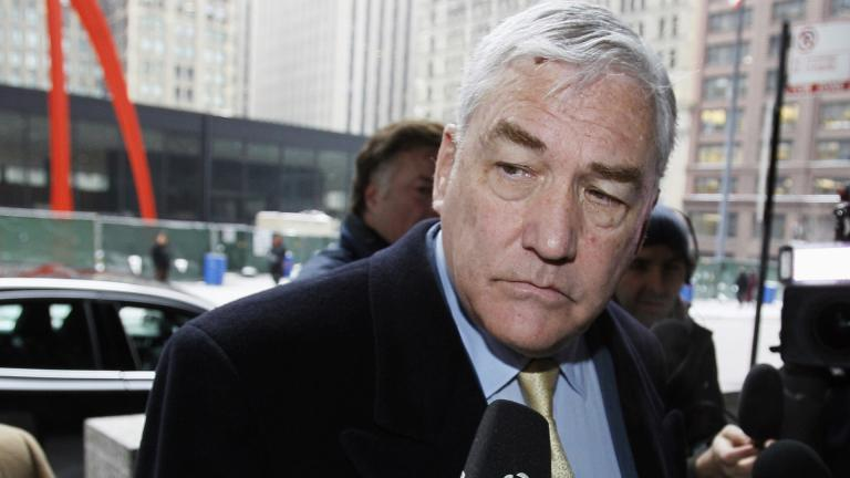 In this Jan. 13, 2011 file photo, Conrad Black arrives at the federal building in Chicago. (AP Photo / Charles Rex Arbogast, File)