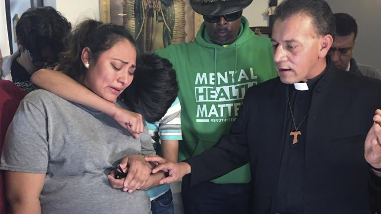 In this Tuesday, May 21, 2019 photo provided by WBEZ Radio is Adilene Marquina, left, as she sobs after announcing she will be seeking sanctuary inside Faith, Life and Hope Mission church on Chicago's Southwest Side. Hugging her is her son, Johan as Rev. Jose Landaverde, right, comforts her. (María Ines Zamudio / WBEZ Radio via AP)