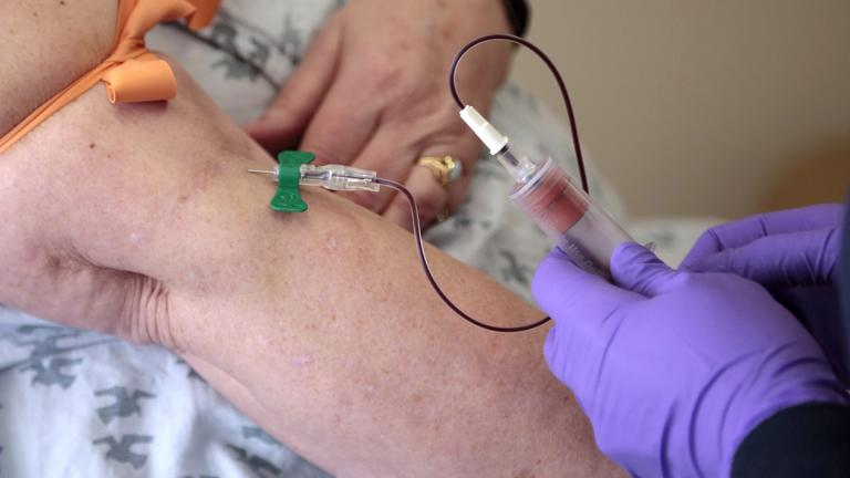 In this Tuesday, April 28, 2015 file photo, a patient has her blood drawn at a hospital in Philadelphia to monitor her cancer treatment. Companies are trying to develop blood tests that can look for signs of many types of cancer at once. (AP Photo / Jacqueline Larma, File)