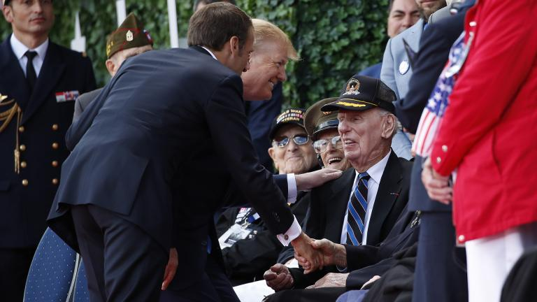 President Donald Trump and French President Emmanuel Macron greet veterans as they arrive to a ceremony to commemorate the 75th anniversary of D-Day at The Normandy American Cemetery, Thursday, June 6, 2019, in Colleville-sur-Mer, Normandy, France. (AP Photo / Alex Brandon)