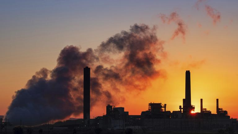 In this July 27, 2018, file photo, the Dave Johnson coal-fired power plant is silhouetted against the morning sun in Glenrock, Wyoming. (AP Photo / J. David Ake, File)