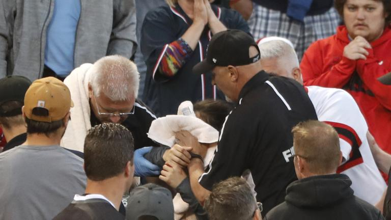 In this Monday, June 10, 2019, file photo, Emergency personal keep a towel on the face of a person who was struck by a line drive by Chicago White Sox's Eloy Jimenez during the fourth inning of a baseball game against the Washington Nationals in Chicago. (AP Photo / Charles Rex Arbogast, File)