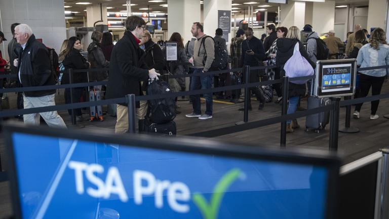 In this Jan. 11, 2019, file photo, passengers wait in line at a Transportation Security Administration checkpoint at the Philadelphia International Airport in Philadelphia. (AP Photo / Matt Rourke, File)