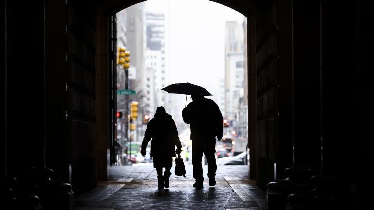 In this Feb. 12, 2019, file photo pedestrians pass beneath City Hall in Philadelphia. (AP Photo / Matt Rourke, File)