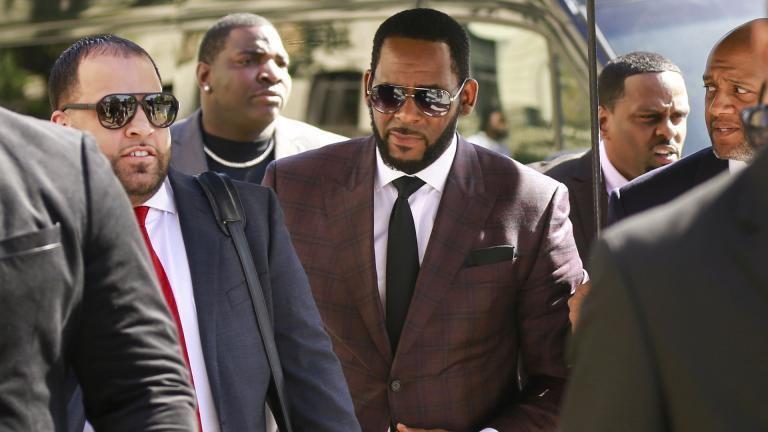 In this June 26, 2019, file photo, R&B singer R. Kelly, center, arrives at the Leighton Criminal Court building for an arraignment on sex-related felonies in Chicago. (AP Photo / Amr Alfiky, File)