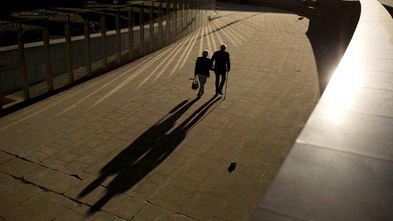 In this Thursday, Sept. 27, 2018 file photo, an elderly couple walks past the Berlaymont building, the European Commission headquarters, in Brussels. (AP Photo / Francisco Seco, File)