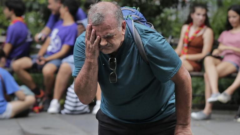 Russ Wilson splashes water on his face from a fountain in New York, Wednesday, July 17, 2019. The heat wave that has been roasting much of the U.S. in recent days is just getting warmed up, with temperatures expected to soar to dangerous levels through the weekend. (AP Photo / Seth Wenig)