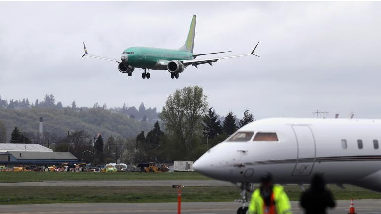 In this April 10, 2019, file photo a Boeing 737 MAX 8 airplane being built for India-based Jet Airways, top, lands following a test flight, Wednesday, April 10, 2019, at Boeing Field in Seattle. (AP Photo / Ted S. Warren, File)