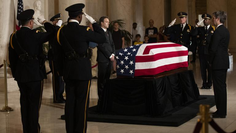 Honor guards salute as they execute the changing of the guard in the Great Hall of the U.S. Supreme Court where the late Supreme Court Justice John Paul Stevens is laying in repose, Monday, July 22, 2019, in Washington. (AP Photo / Manuel Balce Ceneta)