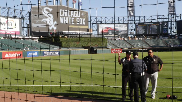 Security personnel at Guaranteed Rate Field are viewed through the newly extended protective netting along left field before a baseball game between the Miami Marlins and the Chicago White Sox, Monday, July 22, 2019, in Chicago. (AP Photo / Charles Rex Arbogast)