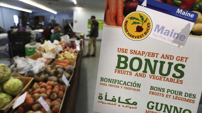In this Friday, March 17, 2017, file photo, a sign advertises a program that allows food stamp recipients to use their EBT cards to shop at a farmer's market in Topsham, Maine. (AP Photo / Robert F. Bukaty, File)