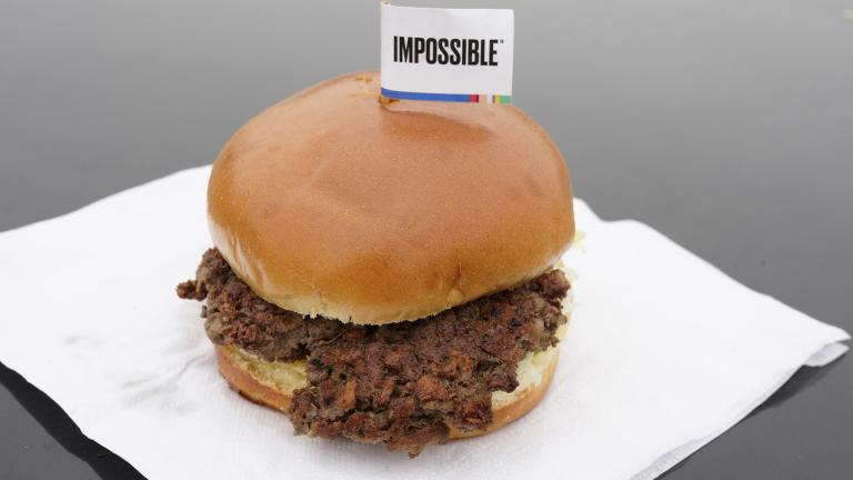 This Jan. 11, 2019, file photo shows the Impossible Burger in Bellevue, Nebraska. After months of shortages, Impossible Foods is partnering with a veteran food production company to ramp up supplies of its popular plant-based burgers. (AP Photo / Nati Harnik, File)