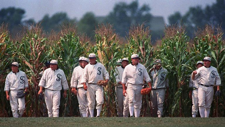 "In this July 22, 1977, file photo, people portraying ghost players emerge from a cornfield as they reenact a scene from the movie ""Field of Dreams"" at the movie site in Dyersville, Iowa. (AP Photo / Charlie Neibergall, File)"