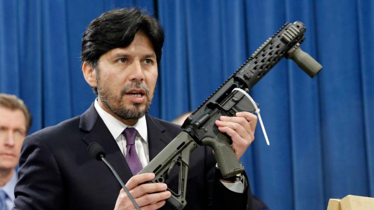 In this Jan. 13, 2014 file photo, former California State Sen. Kevin de Leon, D-Los Angeles, displays a homemade fully automatic rifle, confiscated by the Department of Justice, at the Capitol in Sacramento, California. (AP Photo / Rich Pedroncelli, File)