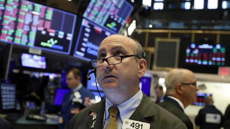 In this Tuesday, Aug. 13, 2019, file photo trader Andrew Silverman works on the floor of the New York Stock Exchange. (AP Photo / Richard Drew, File)