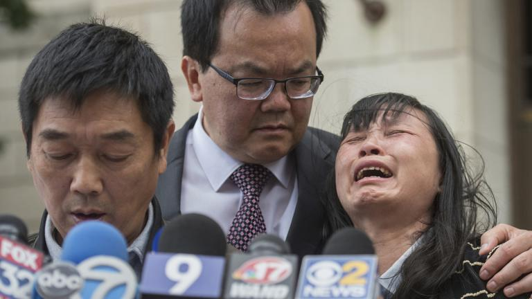 In this Monday, June 24, 2019 file photo, Lifeng Ye, the mother of slain University of Illinois scholar Yingying Zhang, cries out in grief as her husband Ronggao Zhang, left, addresses the media after a jury found Brendt Christensen guilty of Yingying Zhang's murder, at the U.S. Federal Courthouse in Peoria, Illinois. Consoling her is family friend Dr. Kim Tee, center. (Matt Dayhoff / Journal Star via AP, File)
