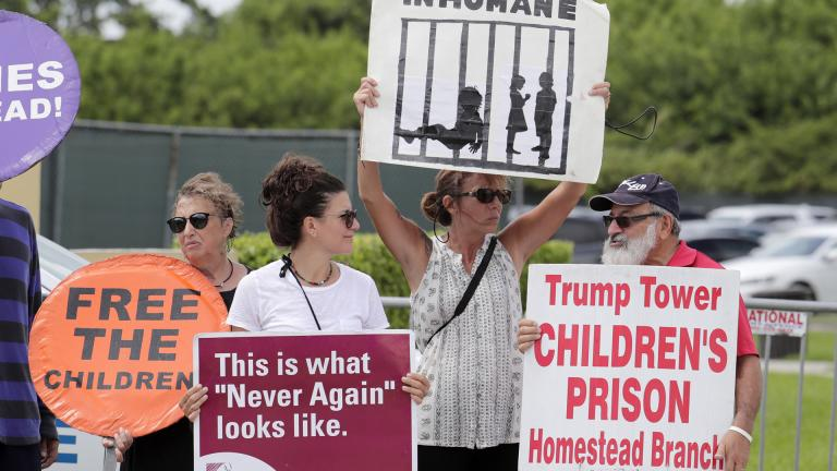 In this July 15, 2019, file photo, protesters hold signs outside of the Homestead Temporary Shelter for Unaccompanied Children while members of Congress tour the facility in Homestead, Florida. (AP Photo / Lynne Sladky, File)