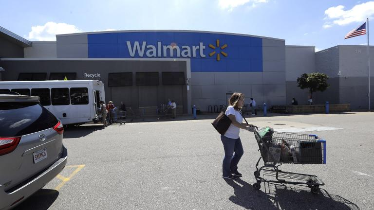 A customer pushes a shopping cart Tuesday, Sept. 3, 2019, outside a Walmart store, in Walpole, Massachusetts. (AP Photo / Steven Senne)
