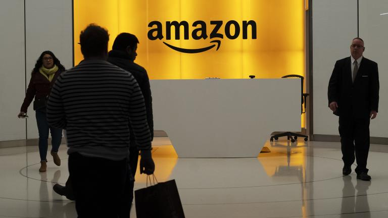 In this Feb. 14, 2019, file photo people walk into the lobby for Amazon offices in New York. (AP Photo / Mark Lennihan, File)