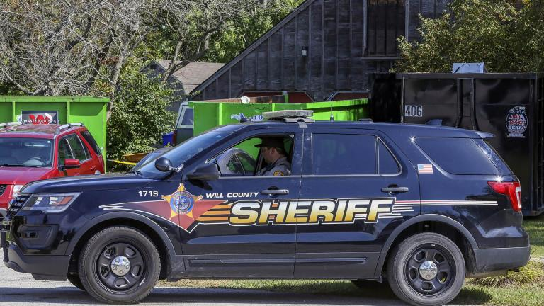 In this Sept. 19, 2019 file photo, Will County Sheriff's patrol is stationed outside the home of deceased Dr. Ulrich Klopfer in unincorporated Crete, Illinois.  (AP Photo / Teresa Crawford, File)