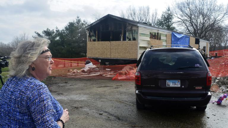 In this Sunday, April 7, 2019, file photo, Marie Chockley, a resident of the Timberline Trailer Court, north of Goodfield, Illinois, surveys the damage that was caused by a Saturday night fire that killed five residents in a mobile home. (Kevin Barlow / The Pantagraph via AP, File)