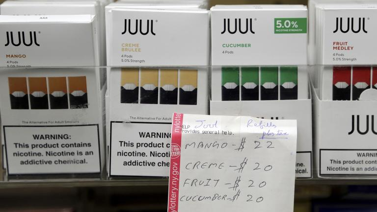 In this Thursday, Dec. 20, 2018 file photo, Juul products are displayed at a smoke shop in New York. (AP Photo / Seth Wenig)