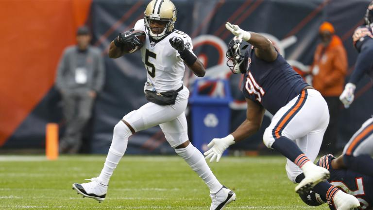 New Orleans Saints quarterback Teddy Bridgewater (5) is chased by Chicago Bears nose tackle Eddie Goldman (91) during the first half of an NFL football game in Chicago, Sunday, Oct. 20, 2019. (AP Photo / Charles Rex Arbogast)