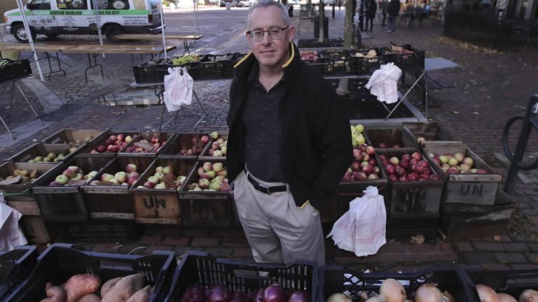 John Gold, self-employed graphics designer, poses at a farmer's market outside his office in Portland, Maine, Wednesday, Oct. 23, 2019. (AP Photo / Charles Krupa)
