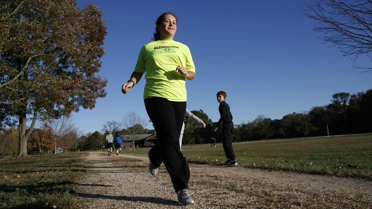"Grace Brown, 14, poses for a portrait while jogging at the park where she does her jogging workouts for her ""online PE"" class, in Alexandria, Virginia on Friday, Nov. 1, 2019. (AP Photo / Jacquelyn Martin)"