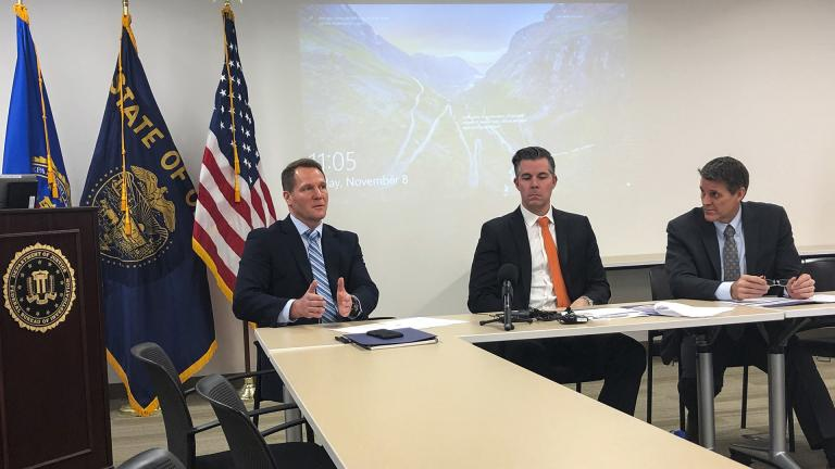 In this Friday, Nov. 8, 2019, photo, FBI Assistant Special Agent in Charge George Chamberlin, from left, speaks as Gabriel Gundersen, an FBI supervisory special agent with the Oregon Cyber Task Force, center, and Loren Cannon, FBI special agent in charge of the Portland Division, in Portland, Oregon to reporters about the rise of cybercrime in Oregon. (AP Photo / Andrew Selsky)