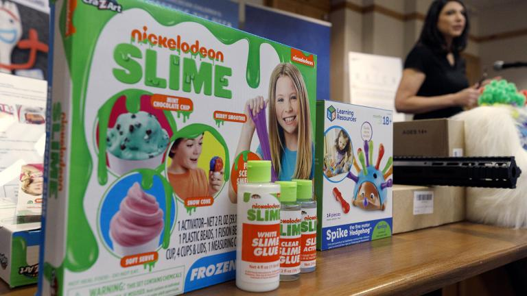 Joan Siff, president of World Against Toys Causing Harm, speaks behind an array of toys, including ice cream-scented Nickelodeon slime, during a news conference in Boston, Tuesday, Nov. 19, 2019. (AP Photo / Michael Dwyer)