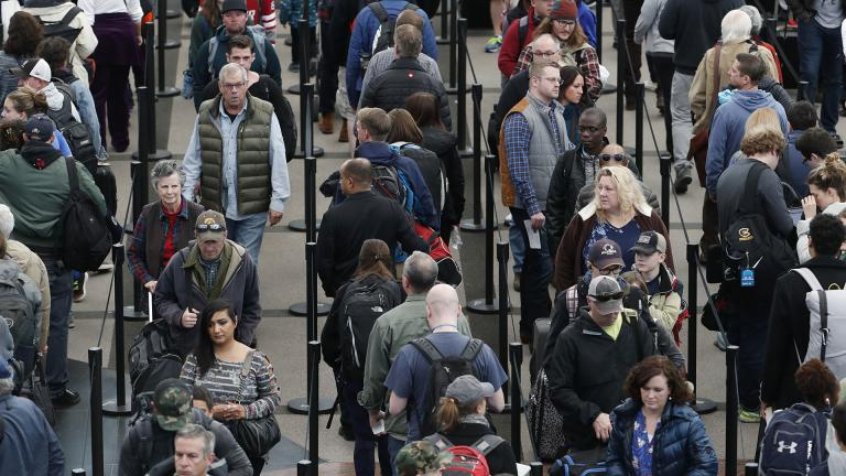In this Nov. 21, 2018, file photo, travelers wait in long lines to pass through a security checkpoint at Denver International Airport in Denver. (AP Photo / David Zalubowski, File)