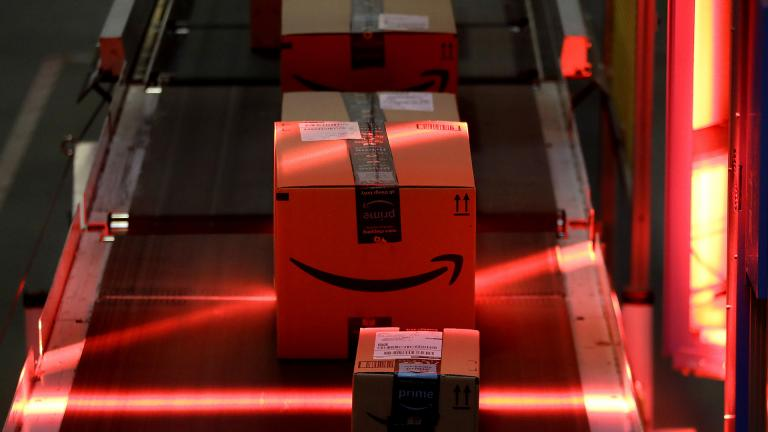In this Aug. 1, 2017, file photo, packages riding on a belt are scanned to be loaded onto delivery trucks at the Amazon Fulfillment center in Robbinsville Township, New Jersey. (AP Photo / Julio Cortez, File)