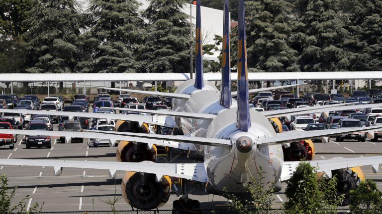 In this Thursday, Aug. 15, 2019, file photo, three grounded Boeing 737 Max airplanes, built for Icelandair, sit parked in a lot normally used for cars in an area adjacent to Boeing Field, in Seattle. (AP Photo / Elaine Thompson, File)