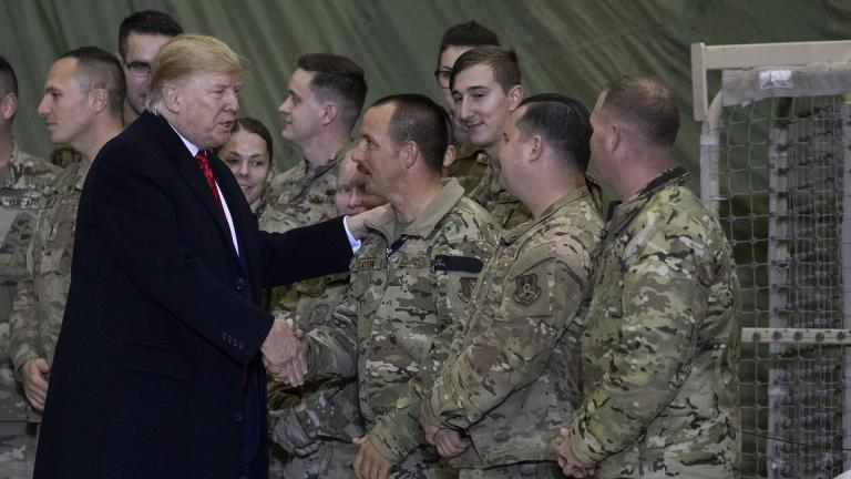 President Donald Trump greeting members of the military after speaking to members of the military during a surprise Thanksgiving Day visit, Thursday, Nov. 28, 2019, at Bagram Air Field, Afghanistan. (AP Photo / Alex Brandon)