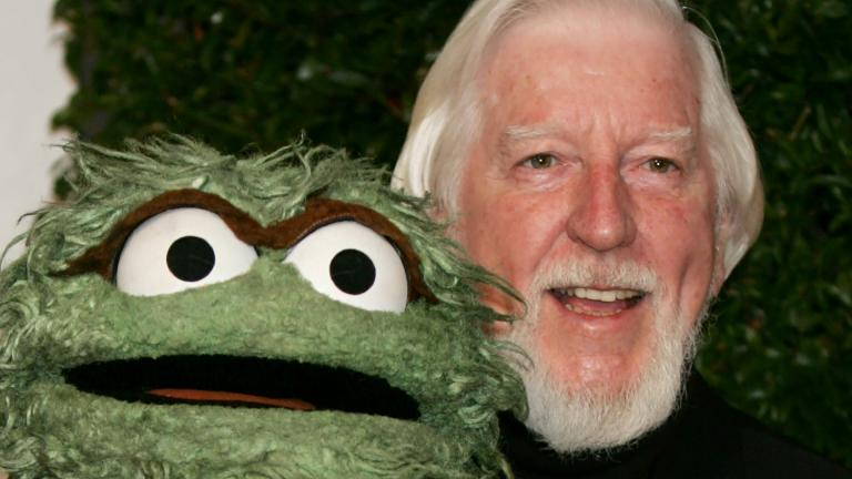 "In this Thursday, April 27, 2006, file photo, Caroll Spinney, right, who portrays ""Sesame Street"" characters Oscar The Grouch, left, and Big Bird, arrives for the Daytime Emmy nominee party at the Hollywood Roosevelt Hotel in Los Angeles. (AP Photo / Reed Saxon, File)"