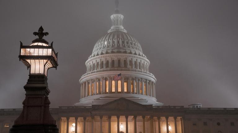 The U.S. Capitol in Washington is shrouded in mist, Friday night, Dec. 13, 2019.  (AP Photo / J. Scott Applewhite)