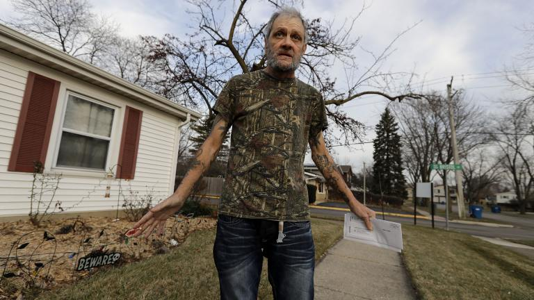 In this Friday, Dec. 20, 2019 photo, Bobby Goldberg walks in front of his home in suburban Chicago. Goldberg has filed a lawsuit claiming he was abused more than 1,000 times in multiple states and countries by the late Donald McGuire, a prominent American Jesuit priest who had close ties to Mother Teresa. (AP Photo / Nam Y. Huh)