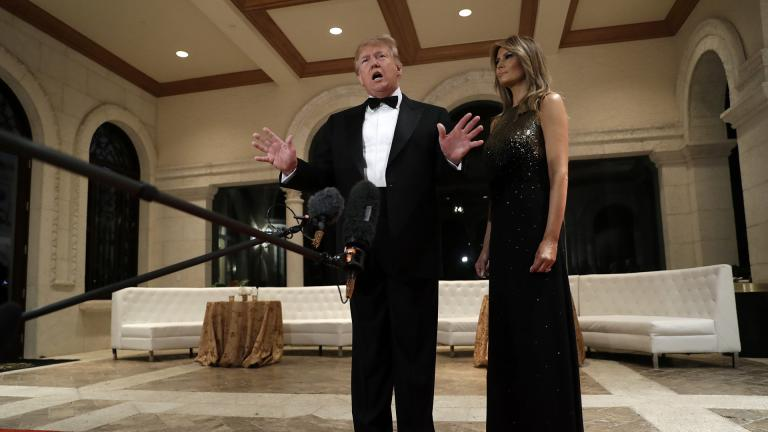 President Donald Trump speaks to the media about the situation at the U.S. embassy in Baghdad, from his Mar-a-Lago property, Tuesday, Dec. 31, 2019, in Palm Beach, Florida, as Melania Trump stands next to him. (AP Photo / Evan Vucci)