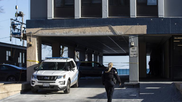 Chicago Police investigate at a South Shore neighborhood high-rise apartment building in the 7200 block of South South Shore Drive, Thursday morning, Jan. 2, 2020. (Ashlee Rezin Garcia / Chicago Sun-Times via AP)