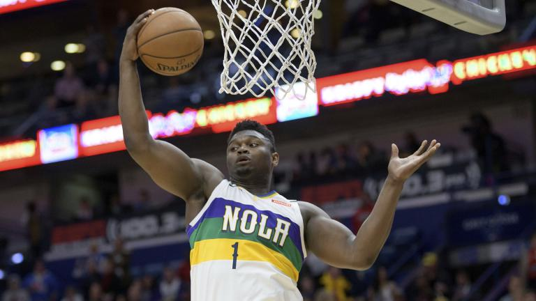 New Orleans Pelicans forward Zion Williamson grabs a rebound during the first half of the team's NBA basketball game against the Oklahoma City Thunder in New Orleans, Thursday, Feb. 13, 2020. (AP Photo / Matthew Hinton)
