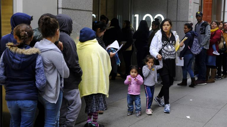 In this Jan. 31, 2019, file photo, hundreds of people overflow onto the sidewalk in a line snaking around the block outside a U.S. immigration office with numerous courtrooms in San Francisco. (AP Photo / Eric Risberg, File)
