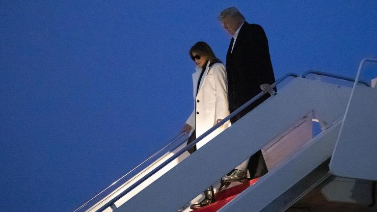 President Donald Trump and first lady Melania Trump step off Air Force One upon their arrival Wednesday, Feb. 26, 2020 at Andrews Air Force Base, Md. Trump is returning from India. (AP Photo / Alex Brandon)