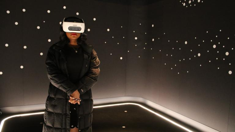 "In this Wednesday, Feb. 26, 2020 photo, a visitor experiences ""The March"" virtual reality exhibit at the DuSable Museum of African American History in Chicago ahead of the project's launch. (AP Photo / Noreen Nasir)"