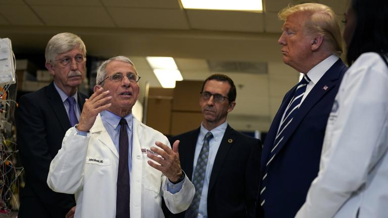 President Donald Trump listens as he tours the Viral Pathogenesis Laboratory at the National Institutes of Health, Tuesday, March 3, 2020, in Bethesda, Md. (AP Photo / Evan Vucci)