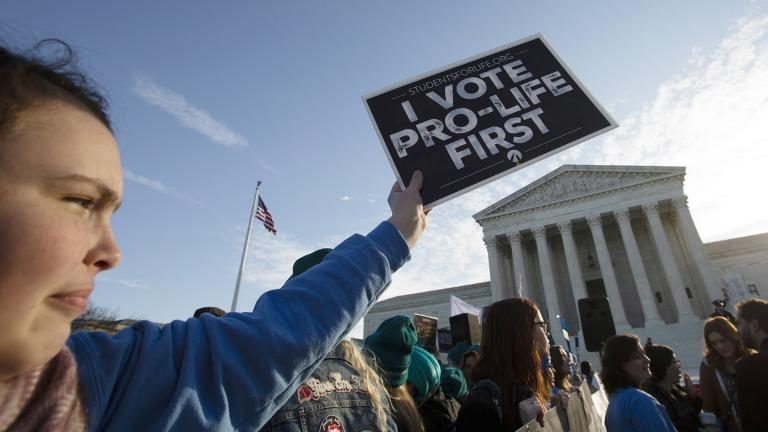 Anti-abortion demonstrators rally outside of the U.S. Supreme Court in Washington, Wednesday, March 4, 2020. (AP Photo / Jose Luis Magana)