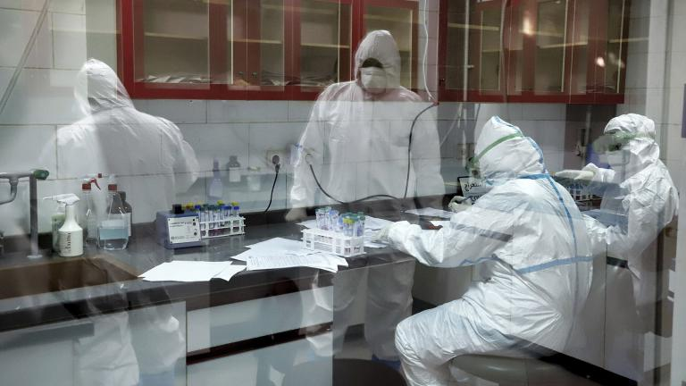 In this Tuesday, March, 10, 2020 photo, paramedics test samples taken from patients suspected of being infected with the new coronavirus, at a laboratory in the southwestern city of Ahvaz, Iran. (Amin Nazari / ISNA via AP)