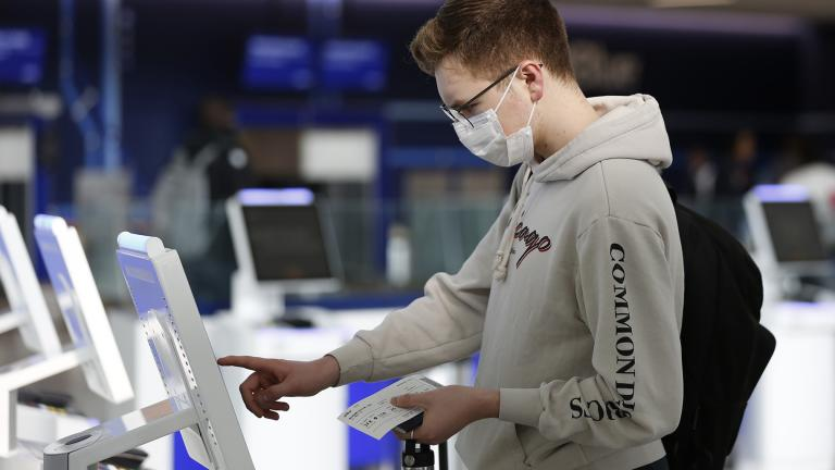 New York University student Hector Medrano, of Los Angeles, checks in for his flight using a touchscreen Saturday, March 14, 2020, at jetBlue's terminal in John F. Kennedy International Airport in New York. (AP Photo / Kathy Willens)