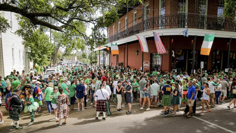 Revelers celebrate St. Patrick's Day Saturday, March 14, 2020, during an unofficial gathering at Tracey's Original Irish Channel Bar in New Orleans. (Scott Threlkeld / The Advocate via AP)
